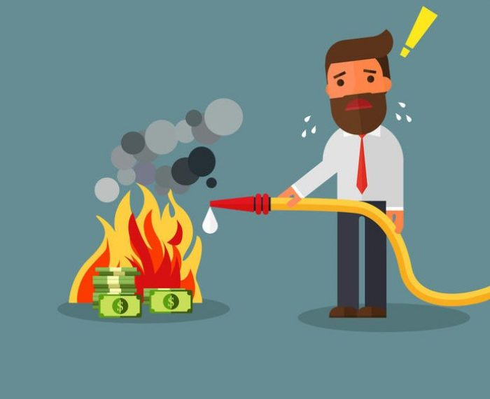 84411170 - businessman fighting fire burning money
