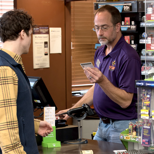 Image of cashier performing age verification